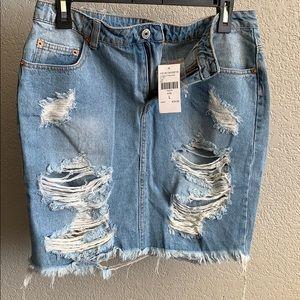 Fashion Nova NWT distressed jean skirt size L